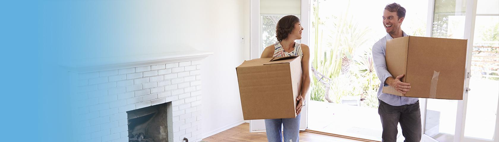 man and woman moving into new home
