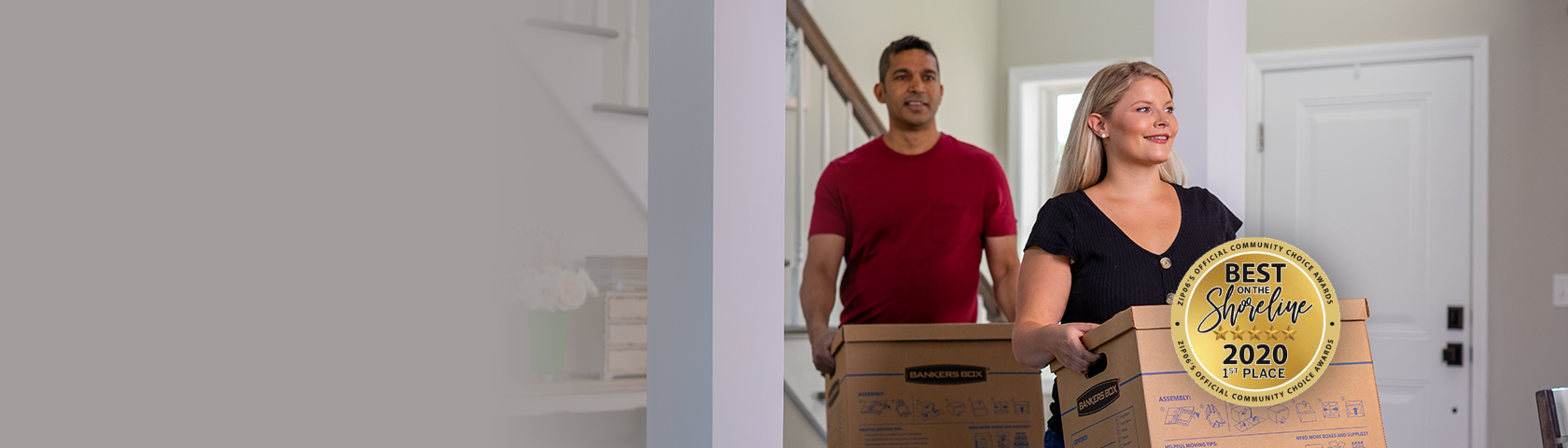 Couple moving in with boxes