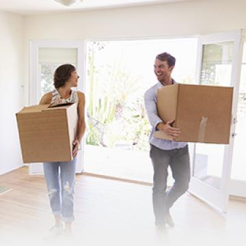 Young Couple moving into new hom