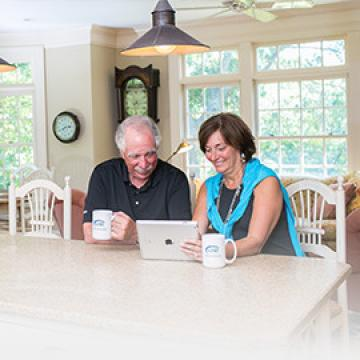 Couple at Table Using iPad