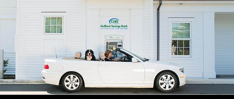 A woman and her dog in a car