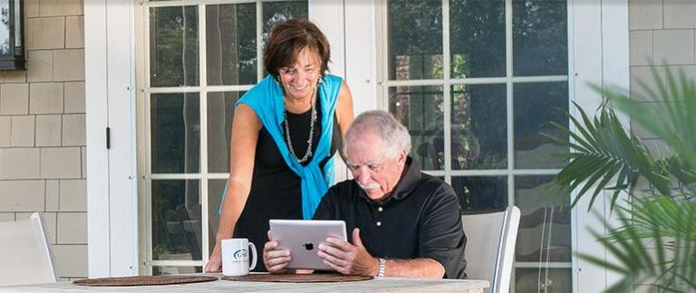 Man looking at Ipad with a Woman